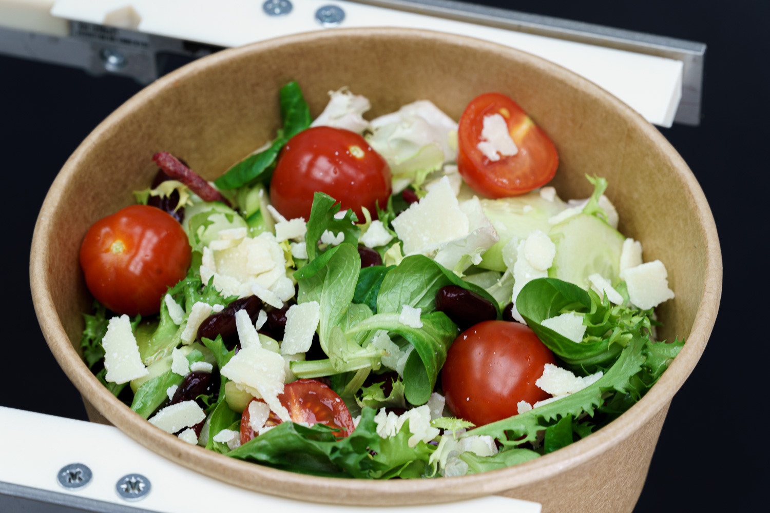 Green salad with cherry tomatoes and parmesan